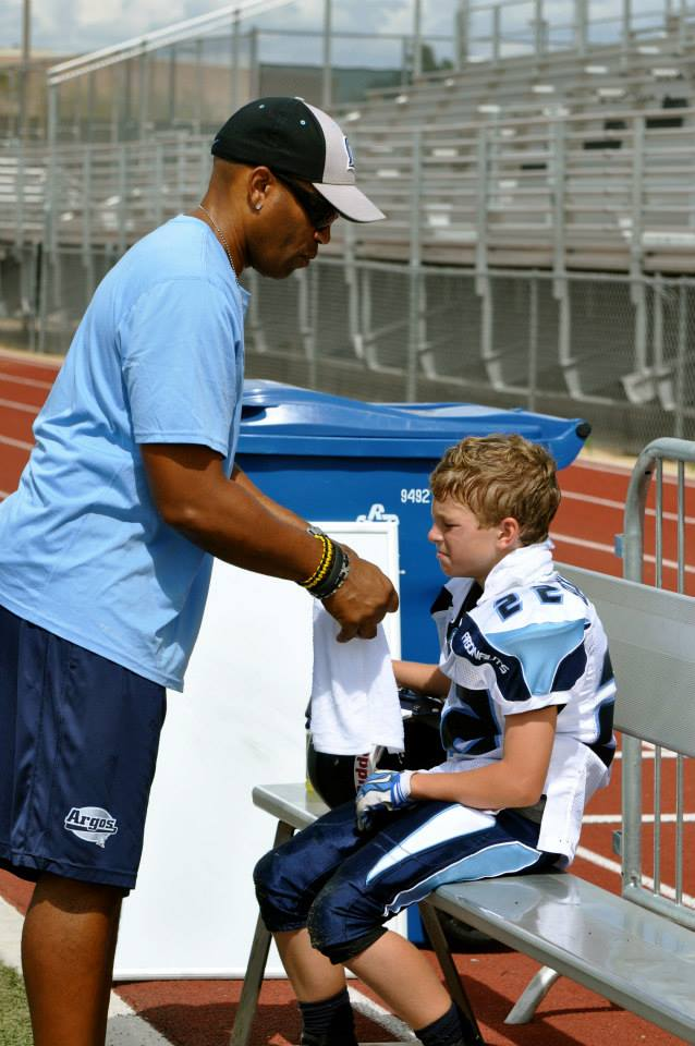 Picture of a coach speaking with a player